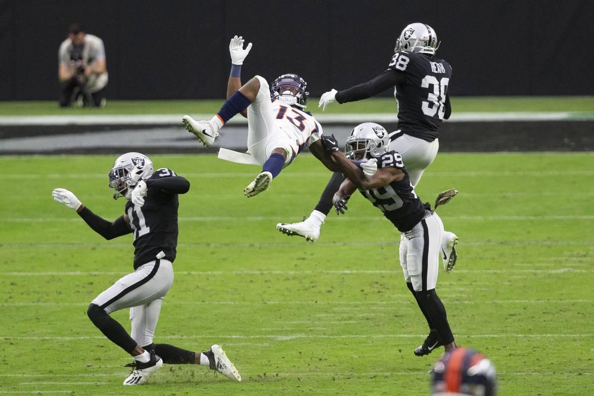 Denver Broncos wide receiver K.J. Hamler (13) goes airborne after getting hit by Las Vegas Raid ...