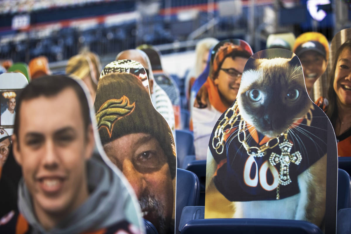 Cardboard cutouts line the stands at Empower Field at Mile High Stadium during an NFL football ...