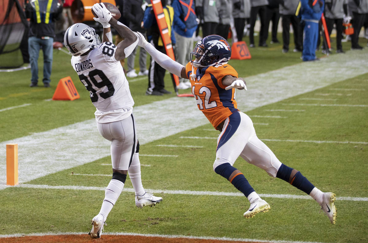 Raiders wide receiver Bryan Edwards (89) catches a touchdown pass over Denver Broncos cornerbac ...