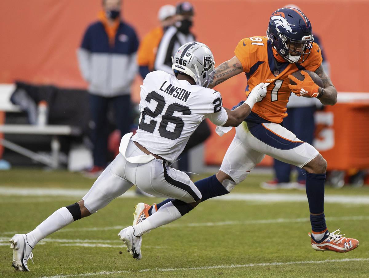 Denver Broncos wide receiver Tim Patrick (81) makes a catch and run past Las Vegas Raiders corn ...