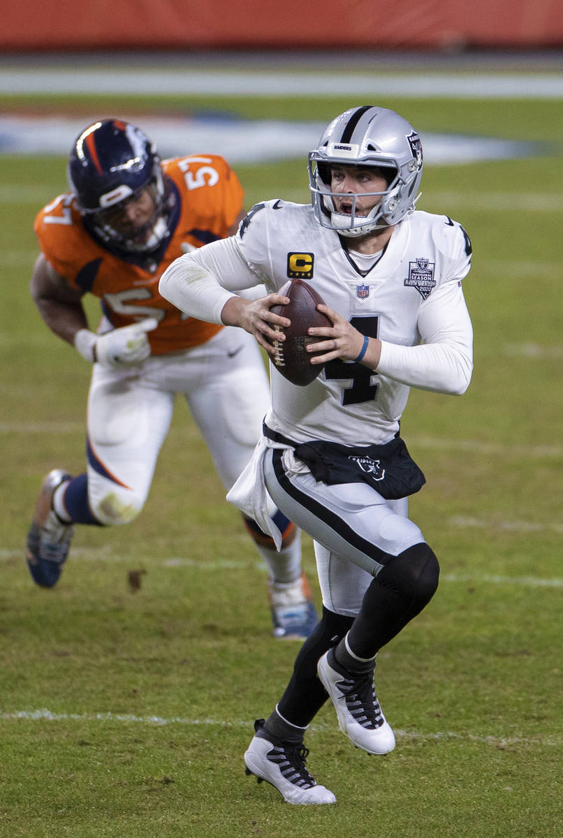 Raiders quarterback Derek Carr (4) scrambles past Denver Broncos defensive end DeMarcus Walker ...