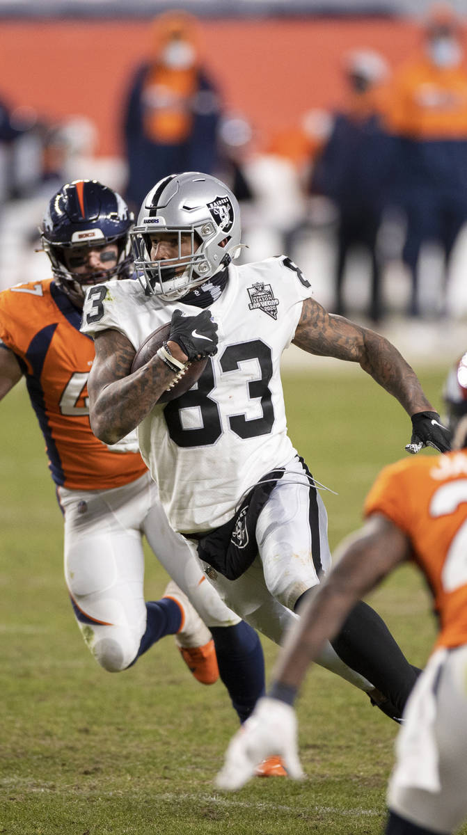 Raiders tight end Darren Waller (83) makes a big run and catch past Denver Broncos inside lineb ...