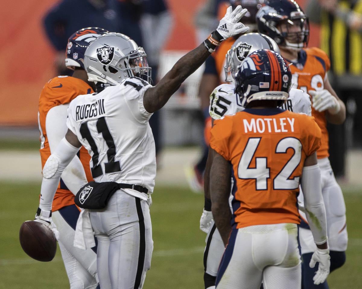 Raiders wide receiver Henry Ruggs III (11) signals a first down in the face of Denver Broncos c ...