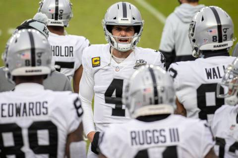 Raiders quarterback Derek Carr (4) fires up his team in the second quarter during an NFL footba ...