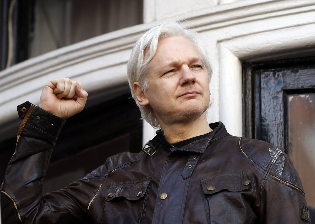 In a May 19, 2017, file photo, WikiLeaks founder Julian Assange greets supporters outside the E ...