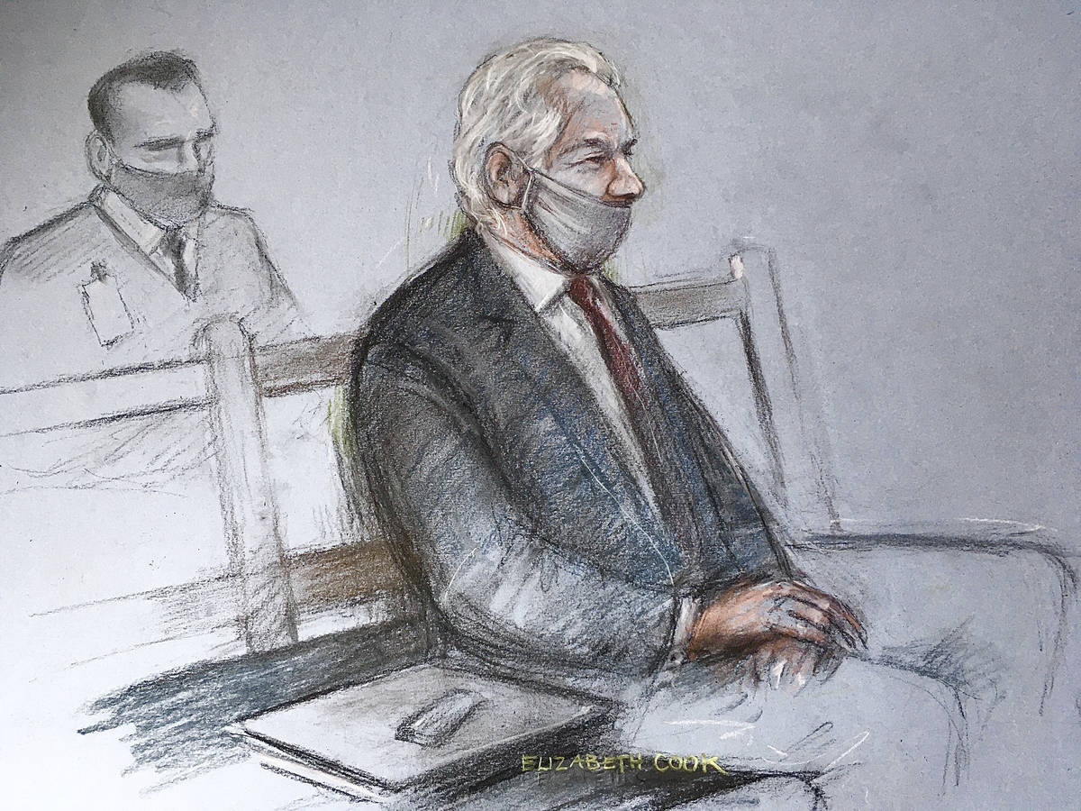 This is a court artist sketch by Elizabeth Cook of Julian Assange appearing at the Old Bailey i ...