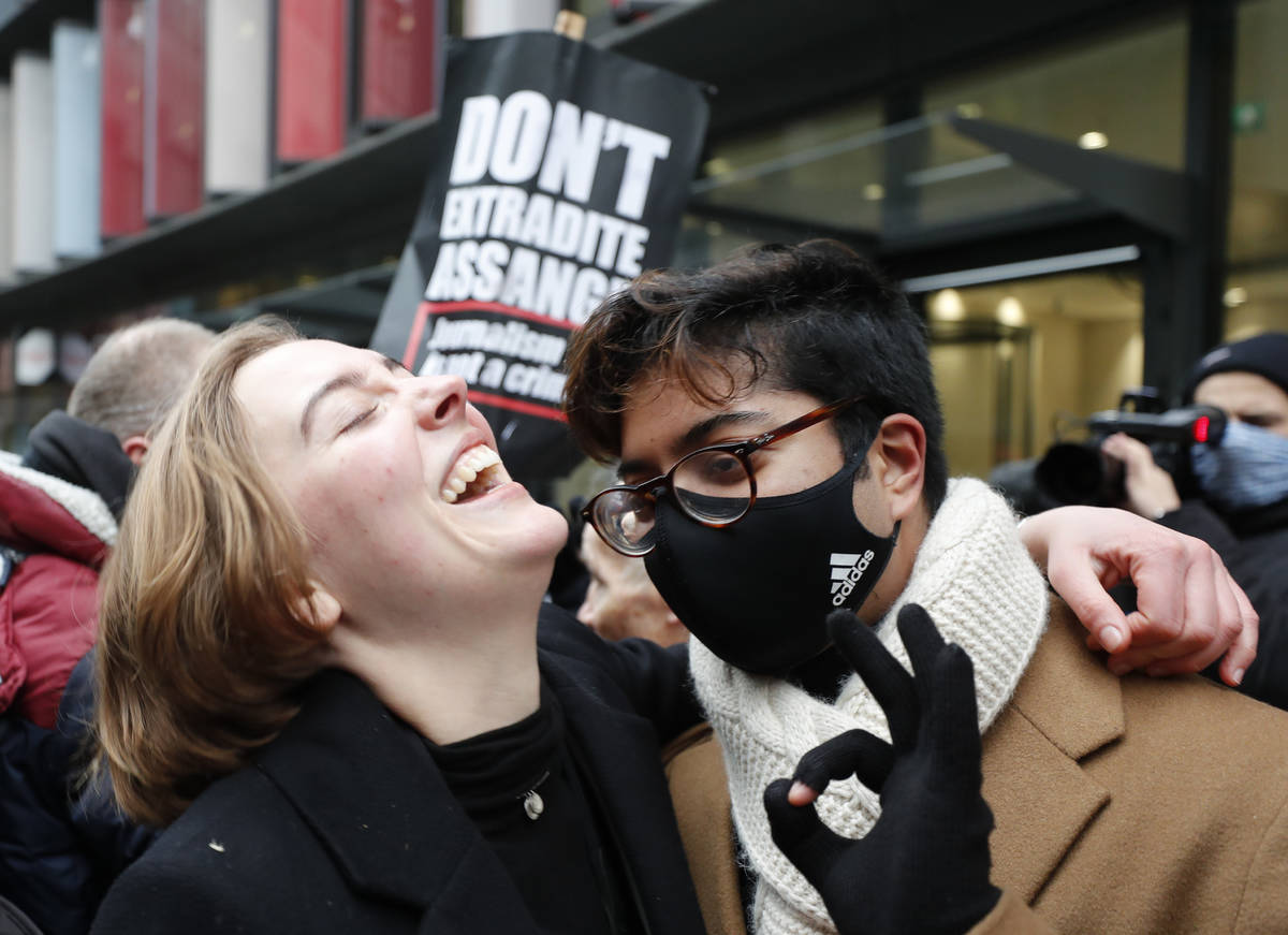Julian Assange supporters celebrate after a ruling that he cannot be extradited to the United S ...