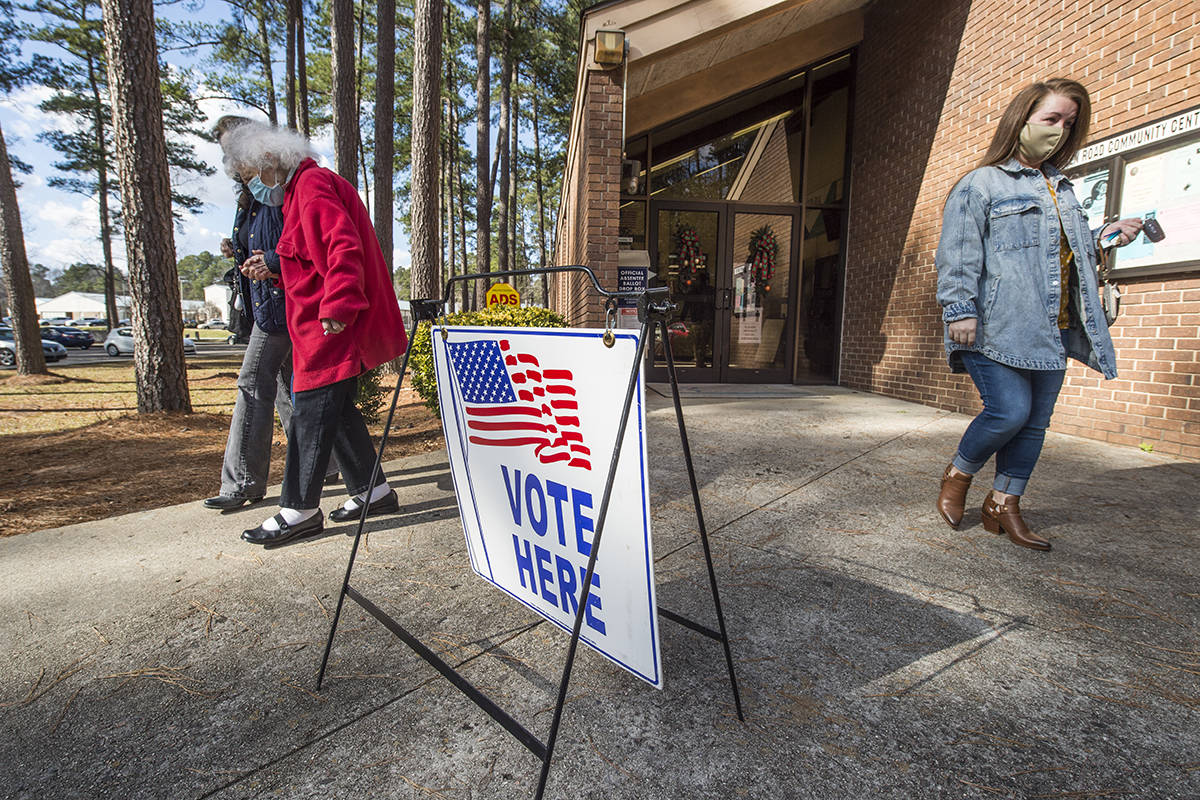 Voters leave the Warren Road Community Center after casting their ballots in Georgia's much ant ...