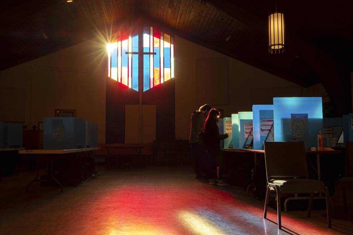 Voters mark their ballots at the Lawrenceville Road United Methodist Church in Tucker, Ga. duri ...