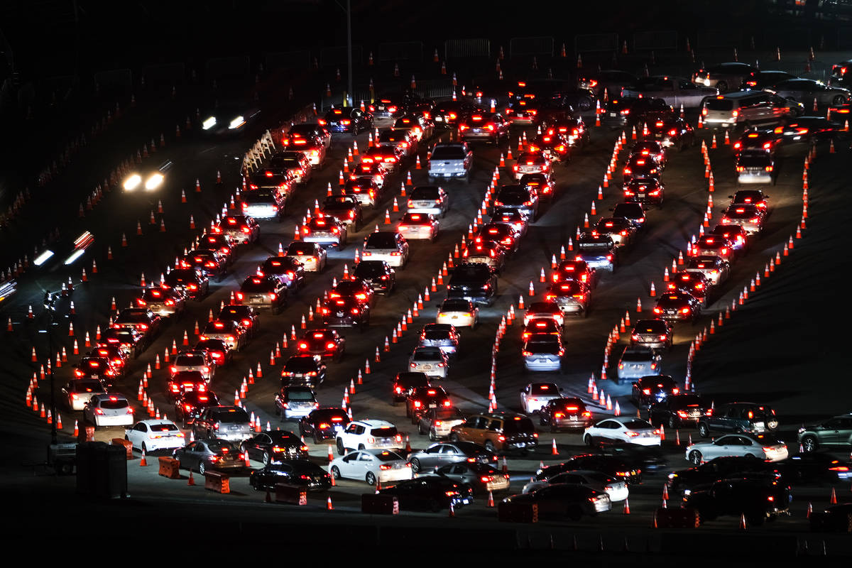 Motorists line up to take a coronavirus test in a parking lot at Dodger Stadium, Monday, Jan. 4 ...