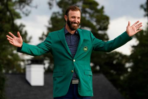 FILE - Masters golf champion Dustin Johnson shows off his green jacket after his victory in Aug ...
