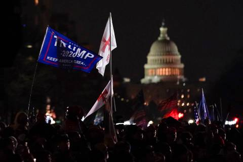 People attend a rally at Freedom Plaza Tuesday, Jan. 5, 2021, in Washington, in support of Pres ...
