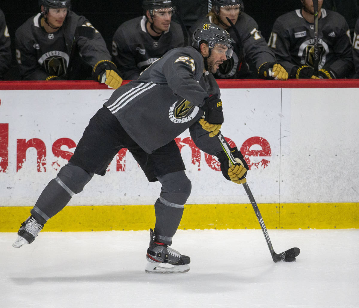 Golden Knights defenseman Alec Martinez (23) shoots the puck on the ice during training camp on ...