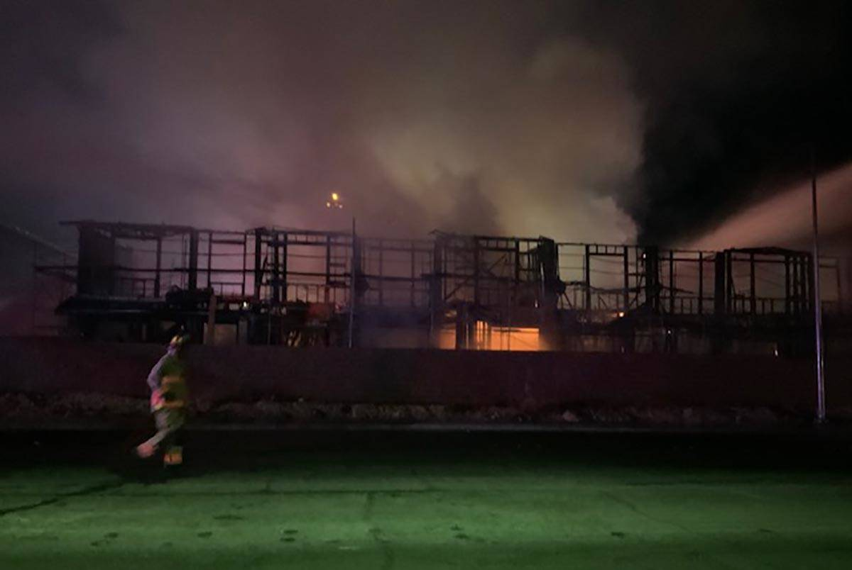 Las Vegas firefighters battle a fire at the Winslow condo development in the 5700 block of Sky ...