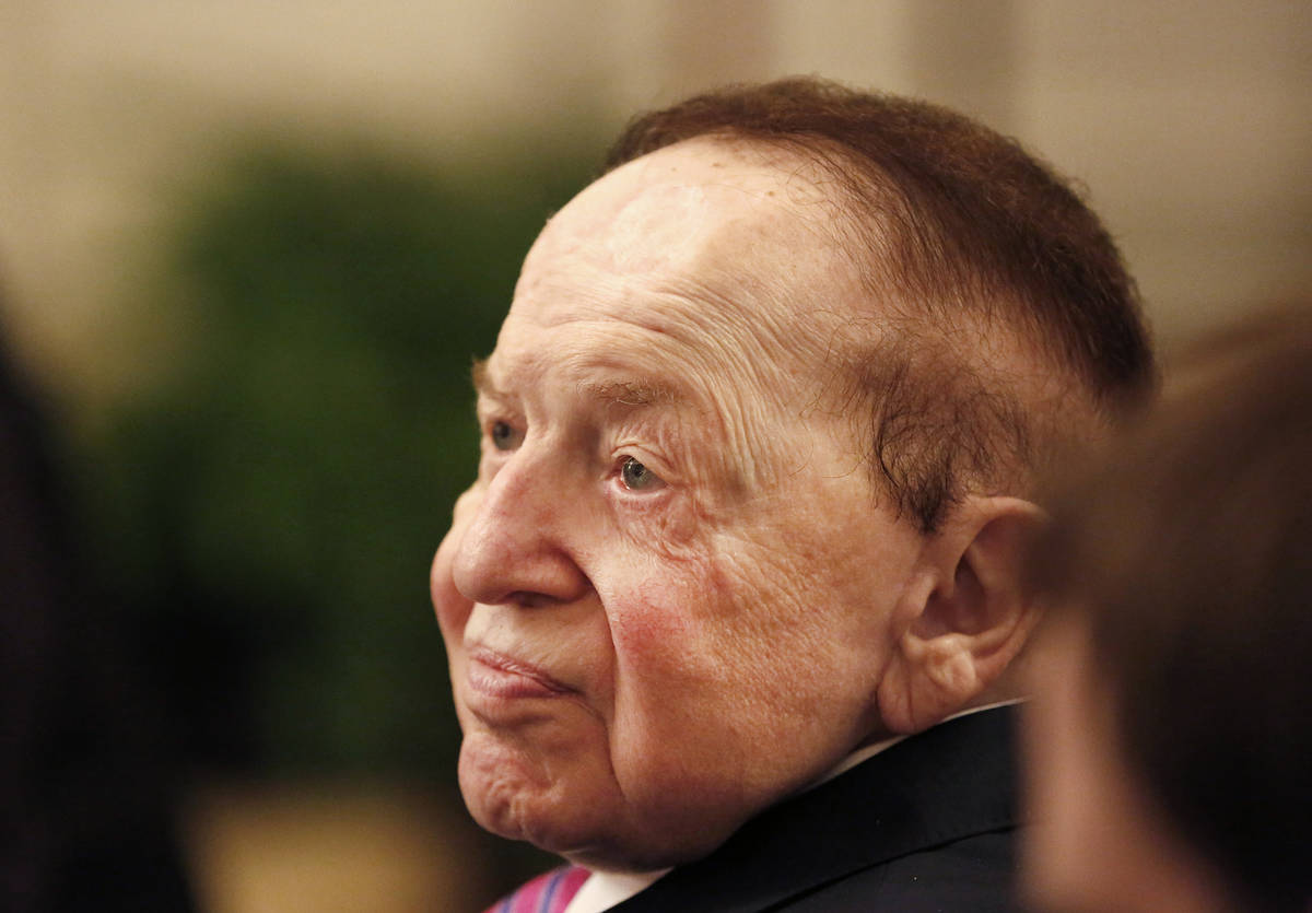 In this Nov. 16, 2018 photo, Sheldon Adelson watches President Donald Trump present his wife, M ...