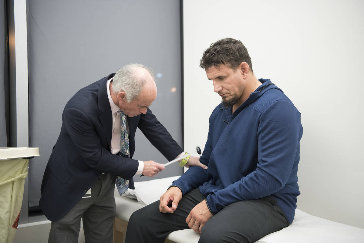 Dr. Charles Bernick conducts a neurological evaluation on a PABHS participant before the COVID- ...