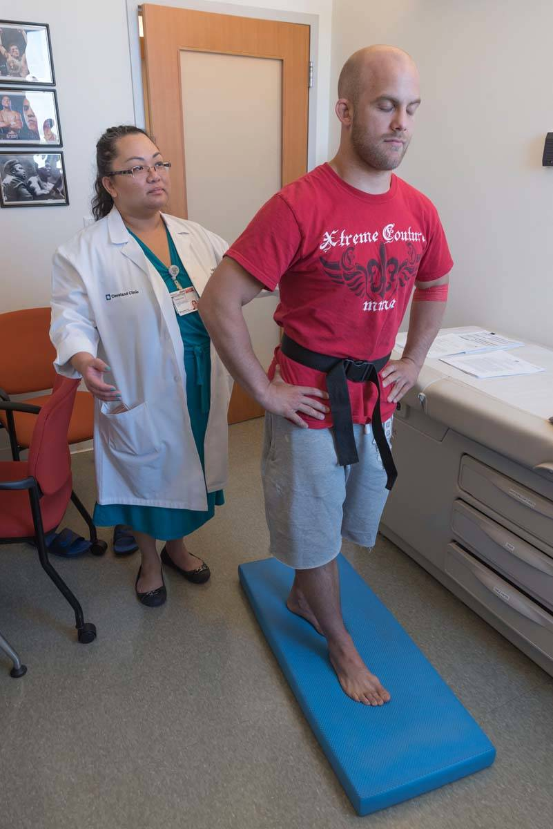 Pamela Dino of Cleveland Clinic administers balance testing as part of the PABHS before the COV ...