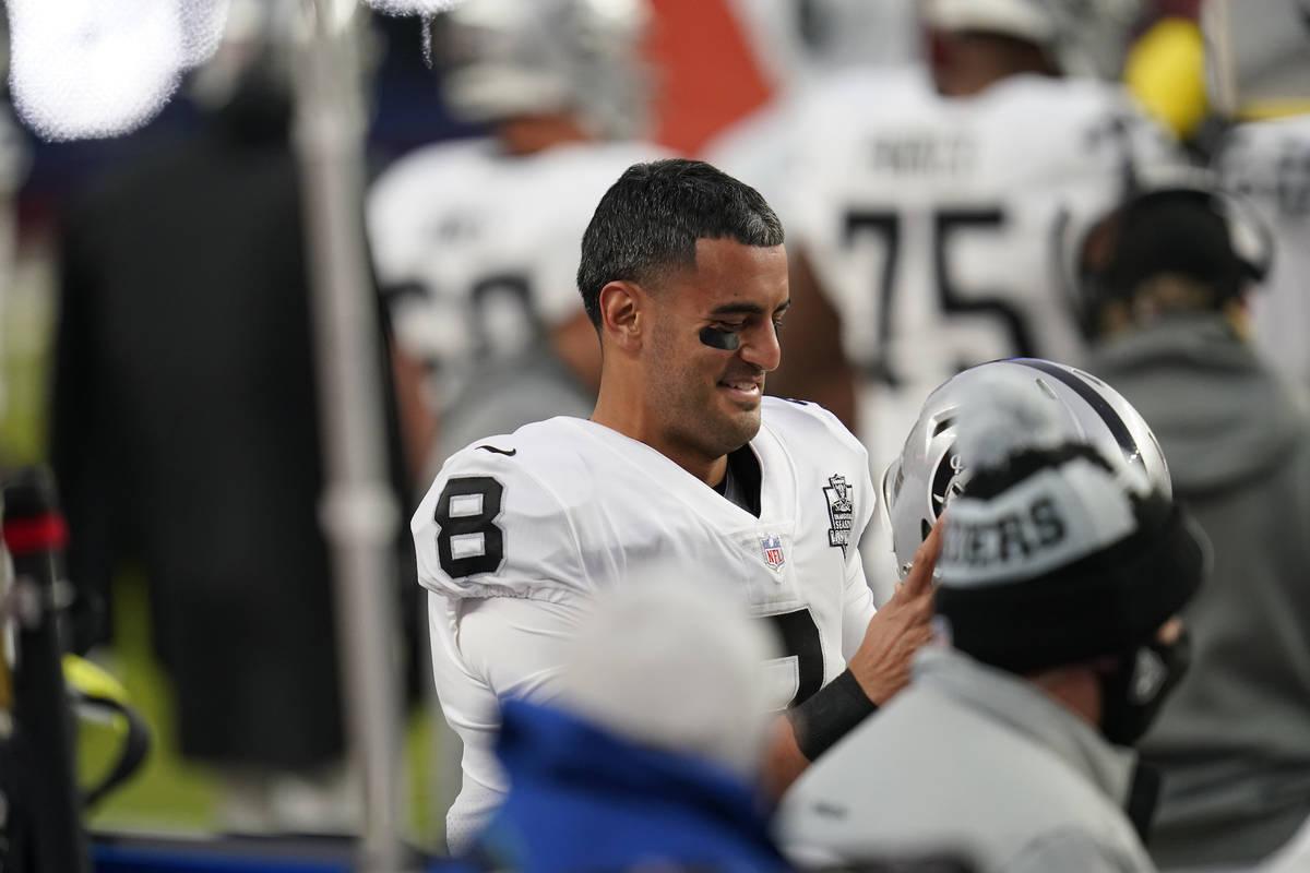 Las Vegas Raiders quarterback Marcus Mariota (8) in the first second half of an NFL football ga ...