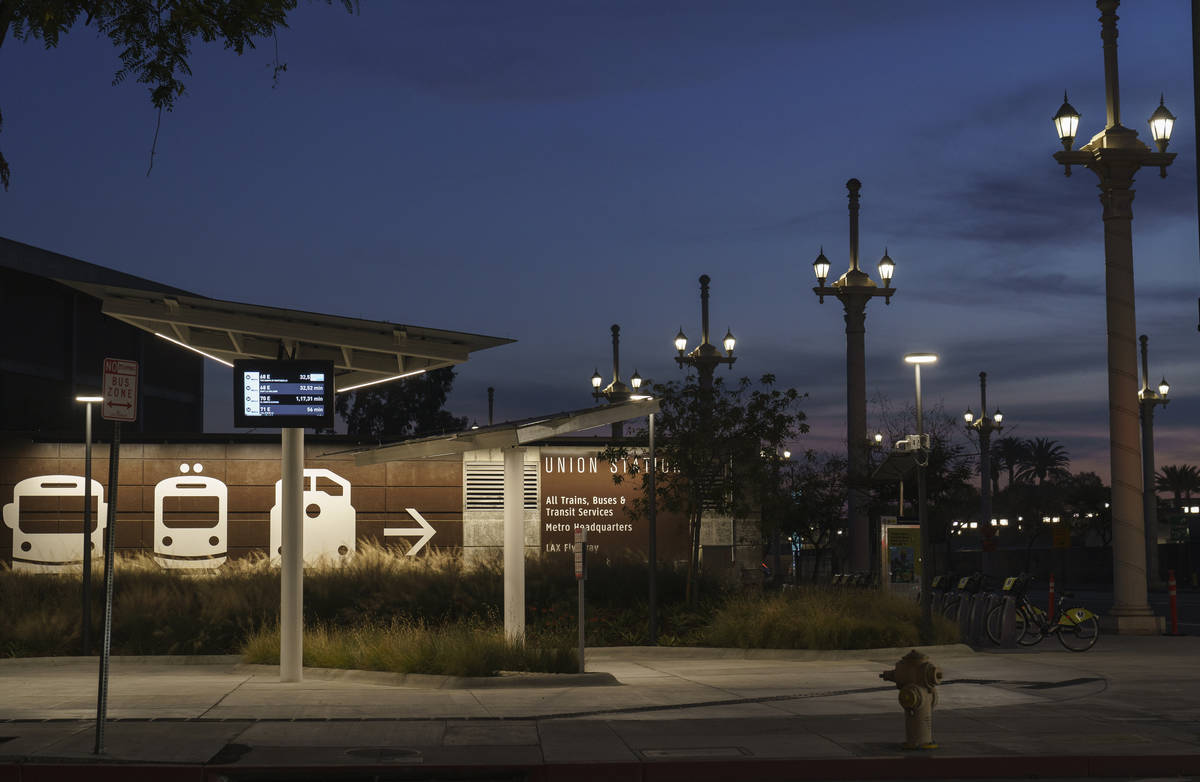 An empty Metro bus stops is seen next to Union Station in Los Angeles late afternoon Tuesday, J ...
