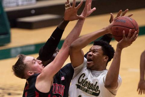 Colorado State forward Dischon Thomas, right, tries for a shot as UNLV forward Moses Wood defen ...