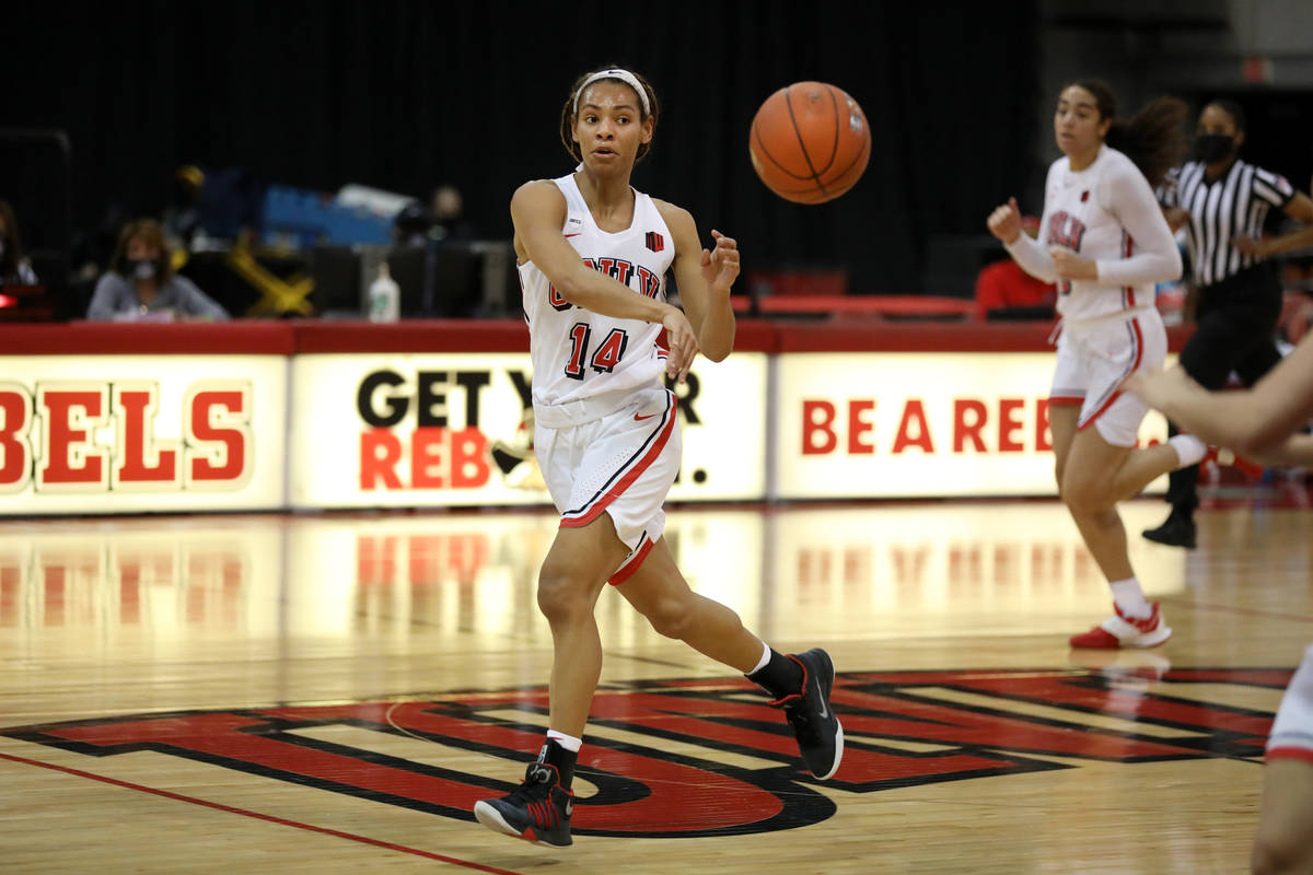 UNLV Lady Rebels guard Bailey Thomas makes a pass against Colorado State University at Cox Pavi ...