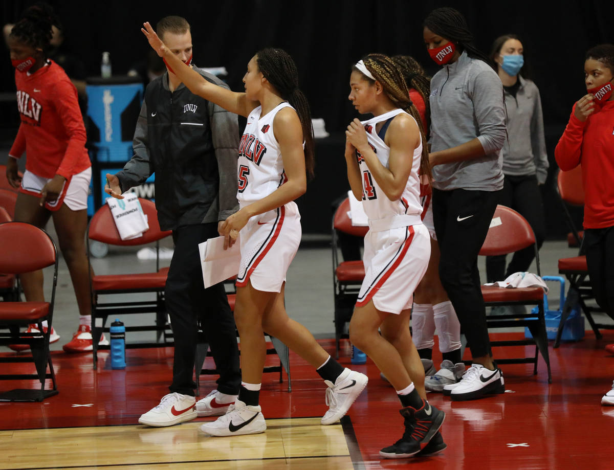 UNLV Lady Rebels guards Jade Thomas, left, and Bailey Thomas enter the second quarter against C ...