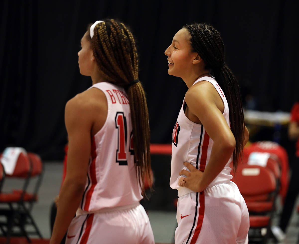 UNLV Lady Rebels guard Bailey Thomas (14), left, and guard Jade Thomas (5), are seen on the cou ...
