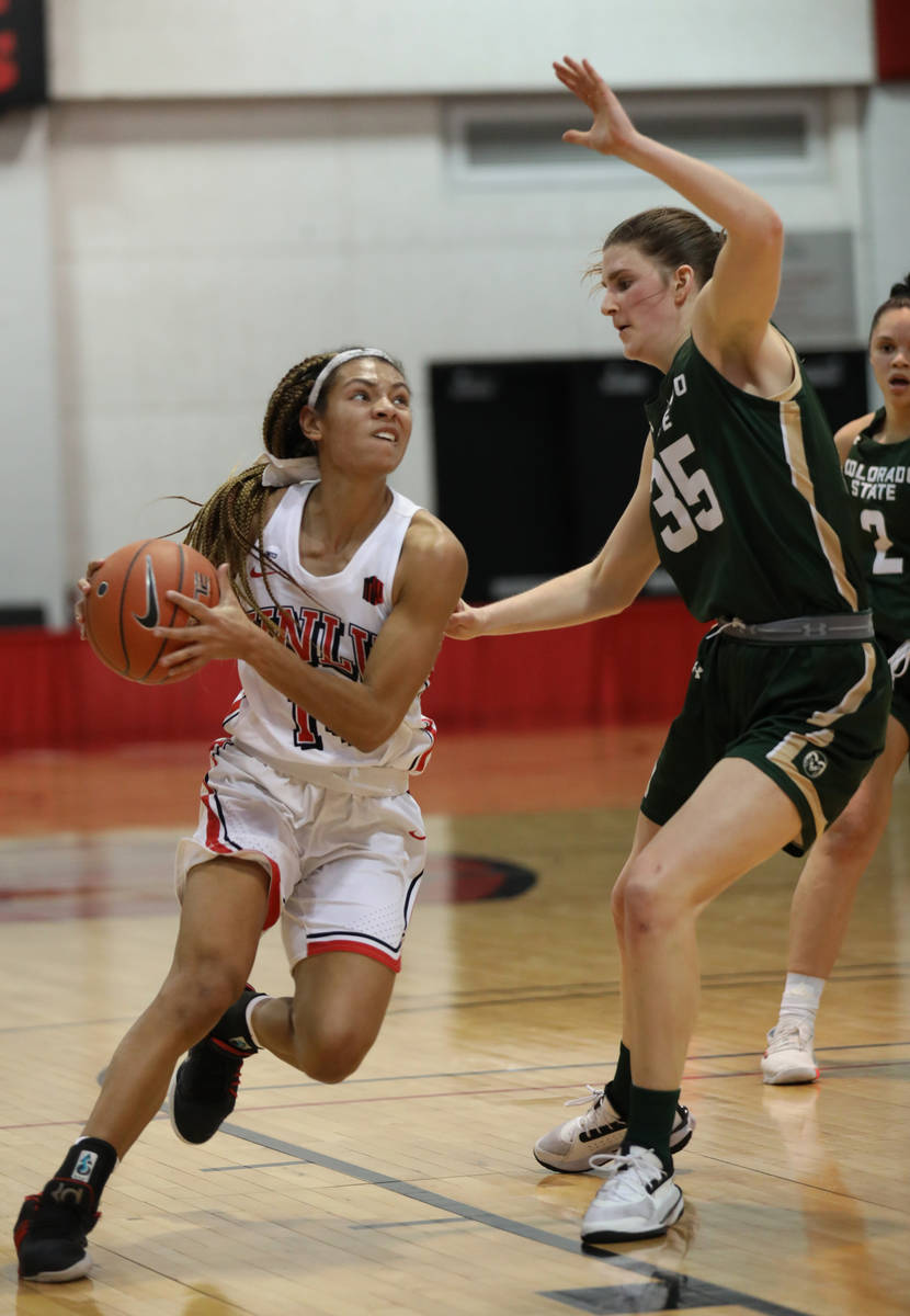 UNLV Lady Rebels guard Bailey Thomas (14) sets up for a lay-up against Colorado State Universit ...