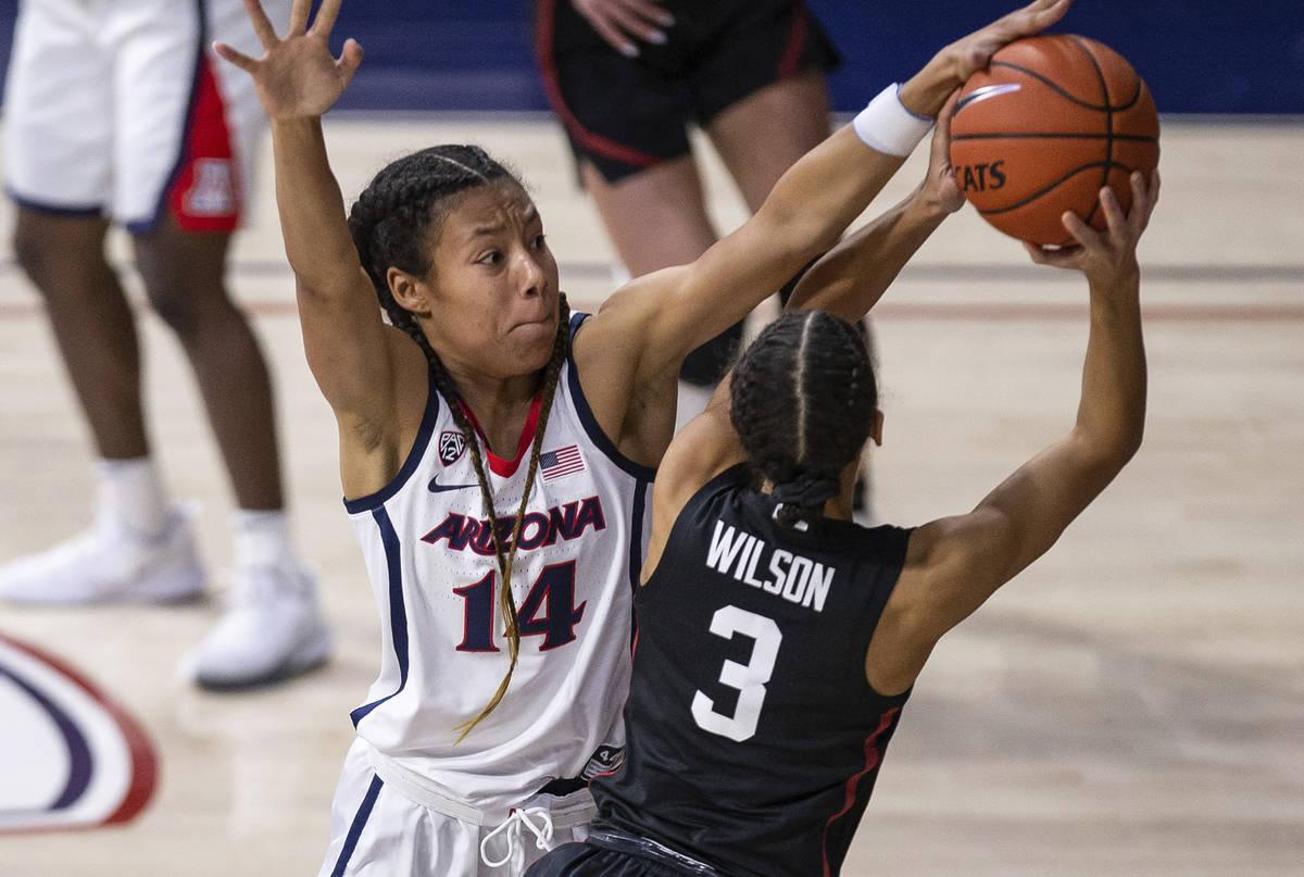 Arizona forward Sam Thomas (14) defends against Stanford guard Anna Wilson (3) during an NCAA c ...