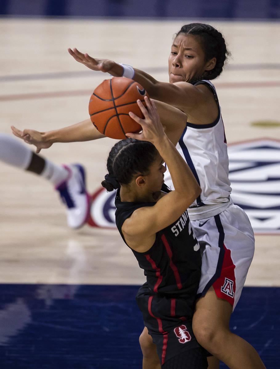 Arizona forward Sam Thomas (14) blocks Stanford guard Anna Wilson (3) during an NCAA college ba ...
