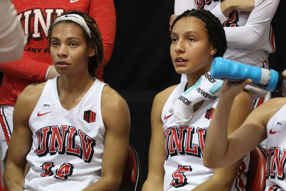 UNLV Lady Rebels guard Bailey Thomas (14), left, and guard Jade Thomas (5), are seen during a t ...