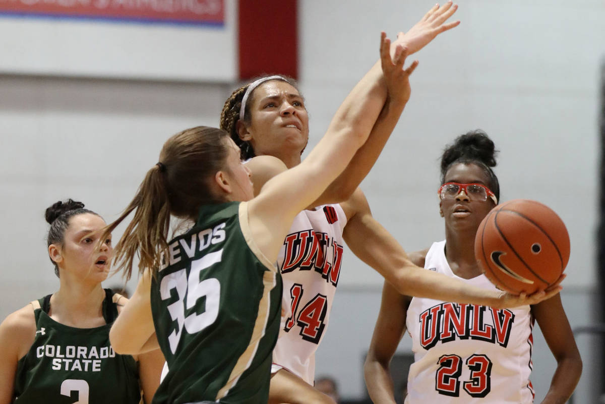 UNLV Lady Rebels guard Bailey Thomas (14) takes a shot against Colorado State University at Cox ...