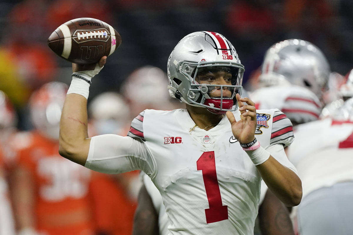 Ohio State quarterback Justin Fields passes against Clemson during the second half of the Sugar ...