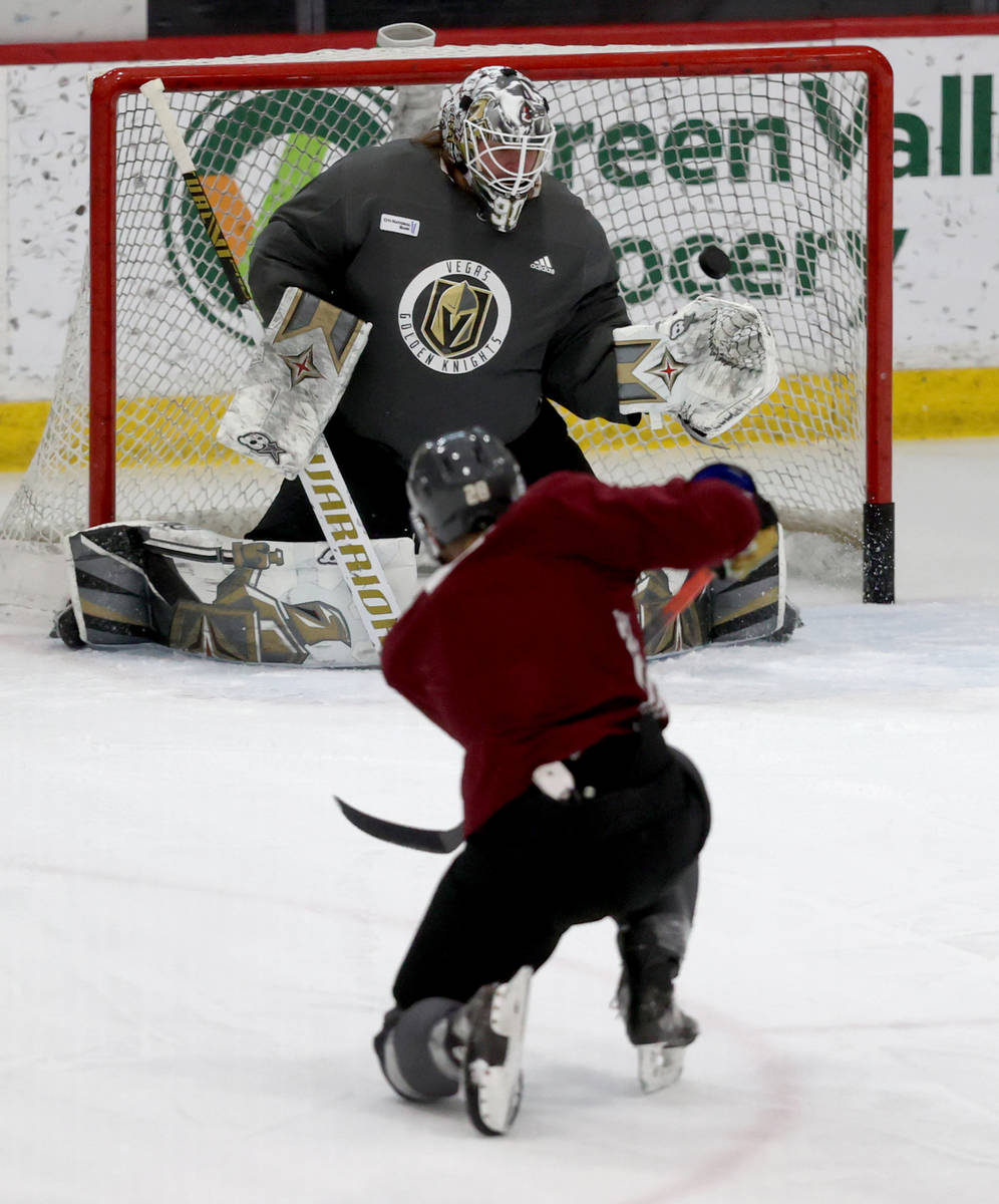 Golden Knights forward William Carrier shoots on goaltender Robin Lehner on the first day of tr ...