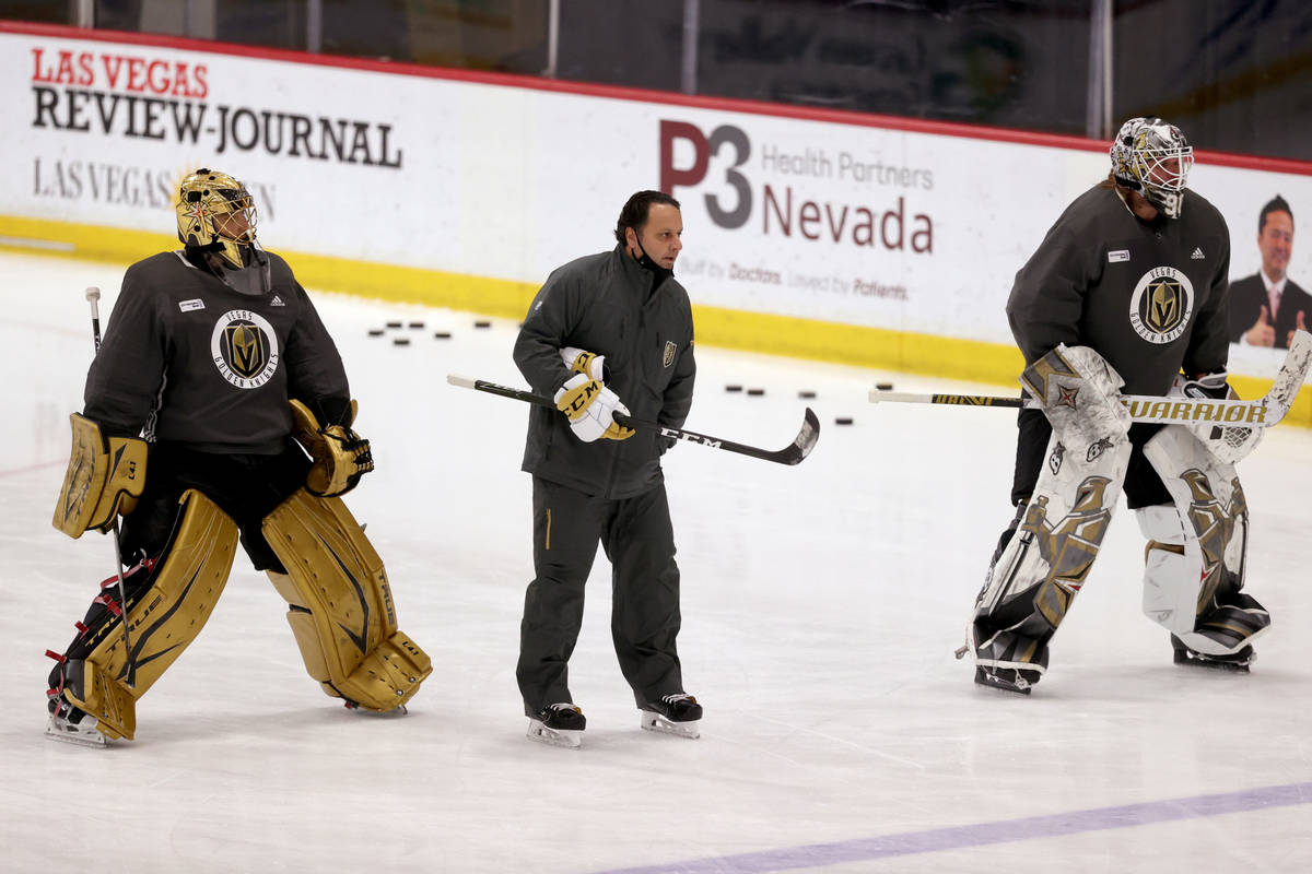 Golden Knights goaltenders Marc-Andre Fleury (29), left, Robin Lehner (90) with coach Mike Rosa ...
