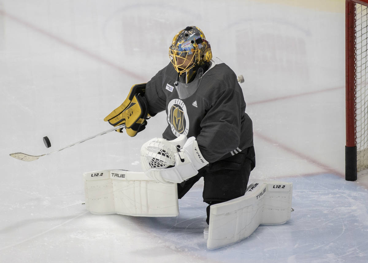 Golden Knights goaltender Marc-Andre Fleury (29) makes a save during practice at City National ...