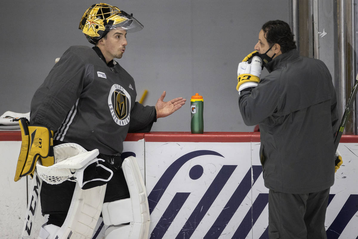 Golden Knights goaltender Marc-Andre Fleury (29) talks with goalie coach Mike Rosario during pr ...