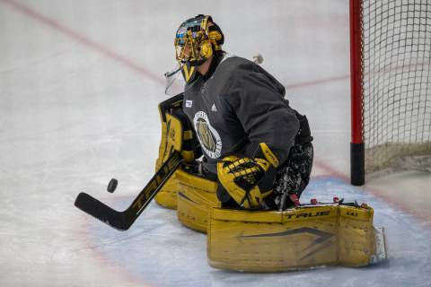 Golden Knights goaltender Marc-Andre Fleury (29) defends his goal during practice on Thursday, ...