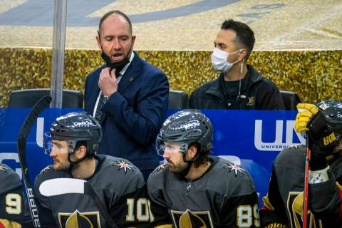Golden Knights head coach Peter DeBoer yells instructions to his players on the bench versus th ...