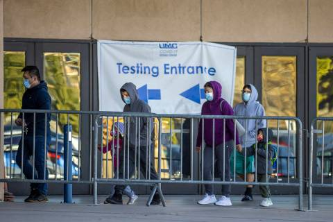 Patients enter as COVID-19 testing continues at the Cashman Center by University Medical Center ...