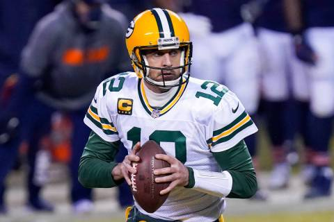 Green Bay Packers' Aaron Rodgers scrambles during the first half of an NFL football game agains ...