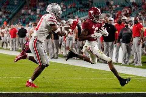 Alabama wide receiver DeVonta Smith scores a touchdown past Ohio State safety Josh Proctor duri ...