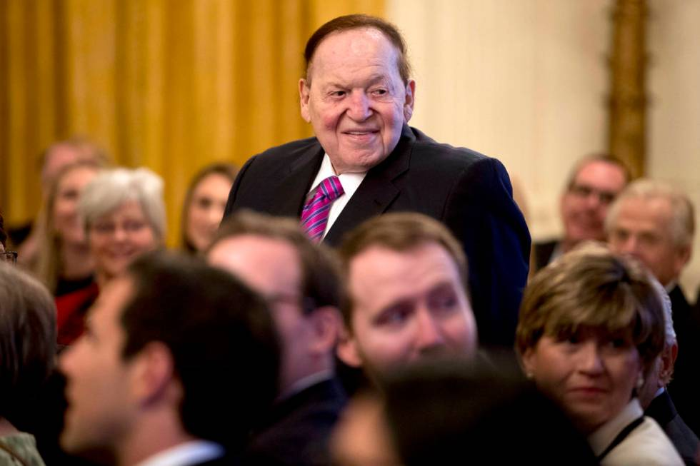 Las Vegas Sands Corp. Chairman and CEO Sheldon Adelson stands as he is recognized by President ...