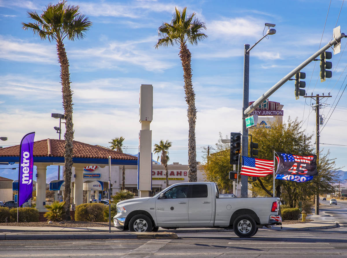 A supporter of President Trump drives their truck on South Highway 160 in Pahrump, Nev. on Mond ...