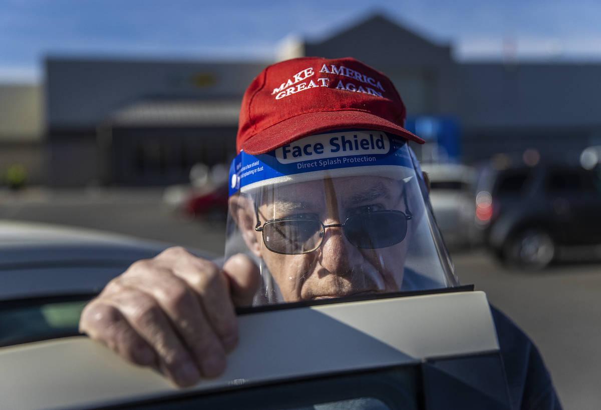 Michael Butler, a supporter of President Trump, outside Walmart Supercenter on Monday, Jan. 11, ...