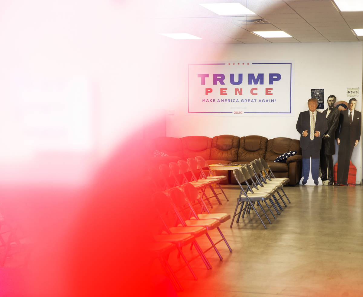 A cardboard cutout of President Trump, left, seen from the window of the Nye County Republican ...