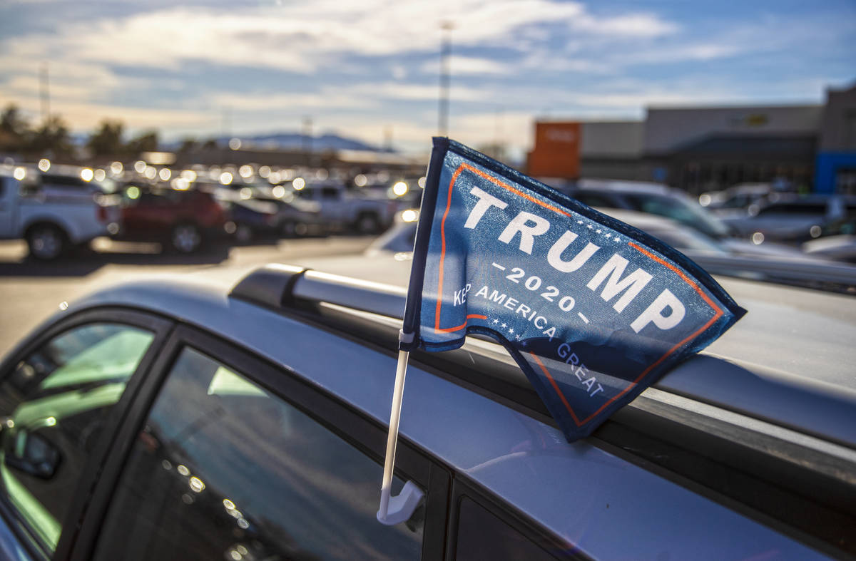 A supporter of President Trump is parked outside Walmart Supercenter on Monday, Jan. 11, 2021, ...