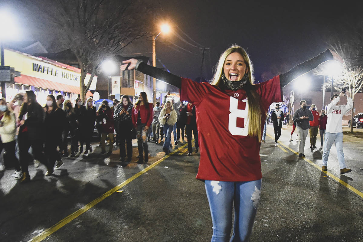 Alabama fans celebrate in the street in Tuscaloosa, Ala., Monday night, Jan. 11, 2021, after Al ...