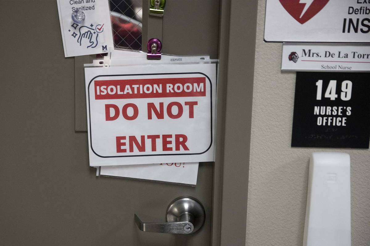 The nurse's office displays a do not enter sign after a sick student visited the room at Mater ...