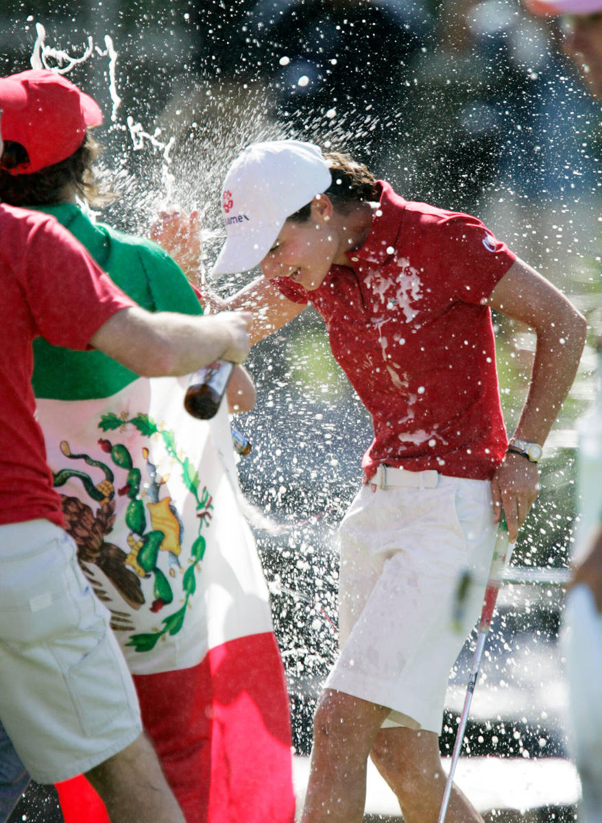 Lorena Ochoa of Mexico is sprayed with champagne and beer by friends and fans after she won the ...